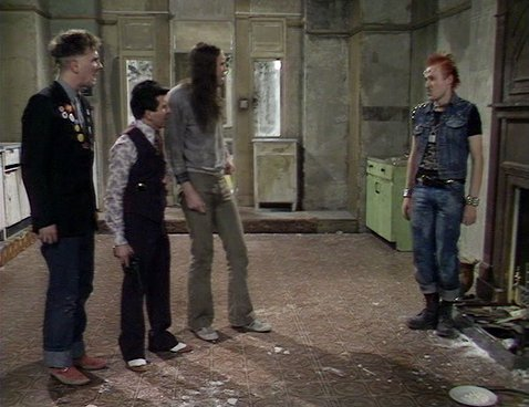 Screengrab from Young Ones episode Cash