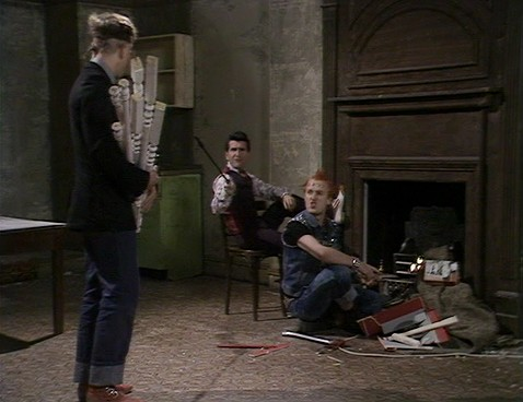 Screengrab from Young Ones episode Cash, showing fire