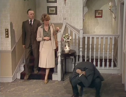 Basil Fawlty suffering one of his many failings and embarrassments