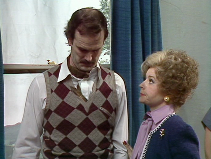 Basil Fawlty with a kipper in his jacket