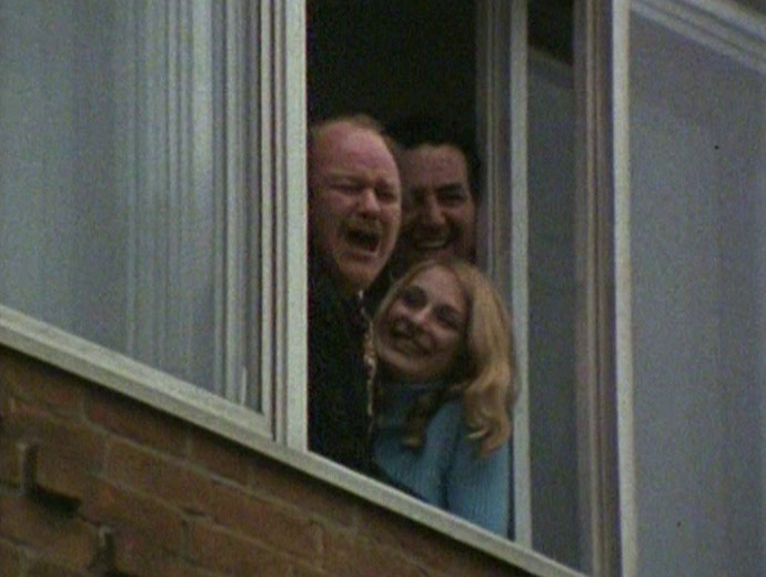 Mr. Davidson and his cronies laughing from an office window